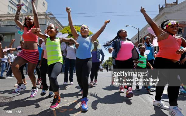 """Children with the """"Dancing Queen Dollz"""", a dance group from San Francisco join the annual Juneteenth Parade rolls through the Fillmore District..."""