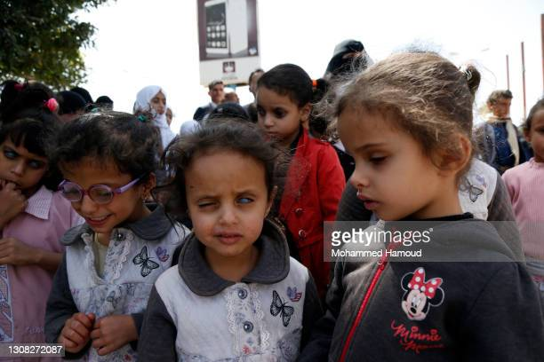 Children with visual impairment take part in a rally held to demand the reopening of the Sana'a airport and resumption of flights, outside the Sana'a...