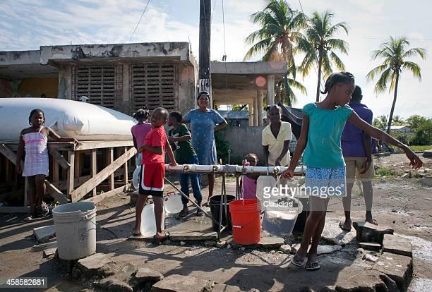 Children with water buckets