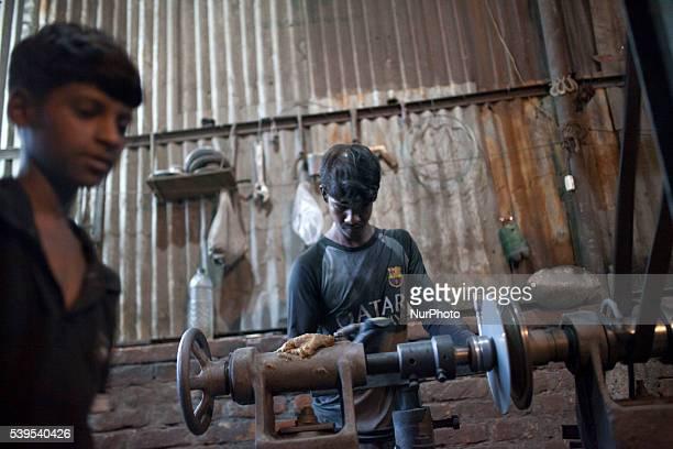 Children working riskey environment inside Aluminium pot factory in Dhaka Bangladesh on June 11 2016 According to ILO more than 168 million children...