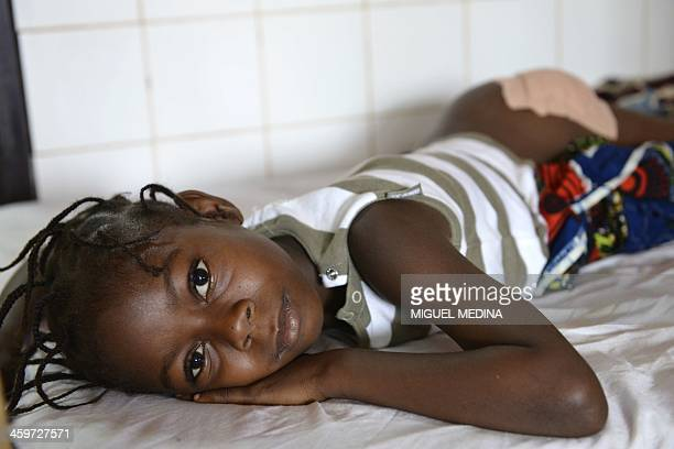Children wounded by grenades bullets or shrapnel in the last 24 hours are treated on December 29 2013 at the Pedriatic hospital in Bangui Most of the...