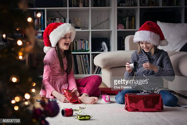 Children wrapping Christmas presents