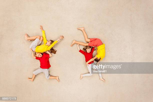 Children wrestling with each other