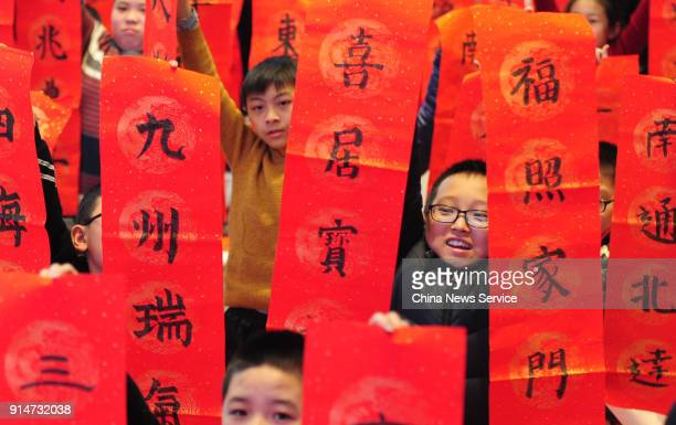 Children write Chinese characters to welcome the Spring Festival on February 5 2018 in Taiyuan China Chinese People are preparing for the upcoming...
