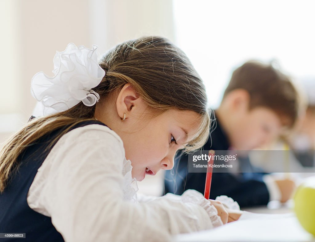 Children writing drawing in class : Stock Photo