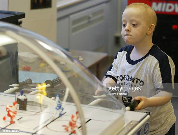 CHILDREN05/19/04In Marnie's Lounge Shane Fenner plays table hockey at the Hospital for Sick Children in Toronto May 19 2004 Marnies Lounge is a spot...