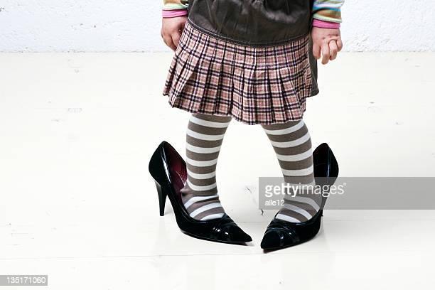 Children´s feet in women´s shoes