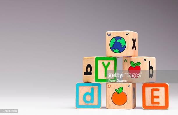 children's alphabet building blocks bricks - education stock pictures, royalty-free photos & images