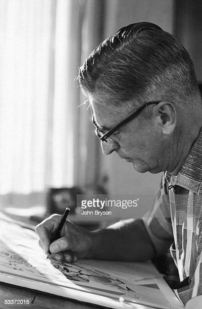 Children's author Theodor Geisel aka Dr Seuss making an illustration for an upcoming book