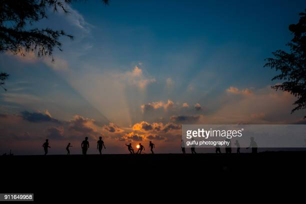 children's beach football match  during sunset - kochi india stock pictures, royalty-free photos & images