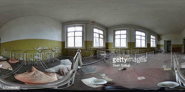 Children's beds stand in an abandoned kindergarten on April 9 2016 in Kopachi Ukraine Zalissya once a village of several hundred households stands...