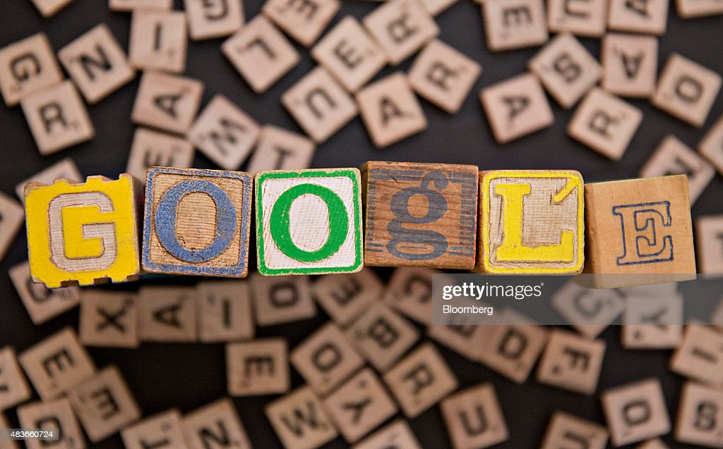 Children's blocks spell out the word 'Google' in this arranged photograph with Hasbro Inc. Scrabble letters taken in Tiskilwa, Illinois, U.S., on Tuesday, Aug. 11, 2015. Google Inc. rose as much as 6.5 percent after reorganizing into a holding company called Alphabet Inc., breaking out its main Web operations from ambitious new endeavors such as research lab Google X and Calico, which seeks to extend human lives. The structure, announced Monday, will give greater clarity into how Google invests in various ventures, including driverless cars, high-speed Internet service and health-related technologies. Photographer: Daniel Acker/Bloomberg via Getty Images