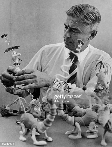 Children's book author/illustrator Theodor Seuss Geisel poses with models of some of the characters he has created