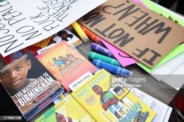 Children's books and markers lay on a table at the Little Black Library in Jefferson Square Park on September 26, 2020 in Louisville, Kentucky. A...