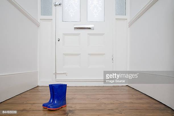 Childrens boots by door