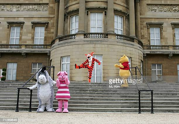 Children's cartoon characters Eeyore Piglet Tigger and Winnie the Pooh are at the Queens garden in Buckingham Palace during the preparation for the...