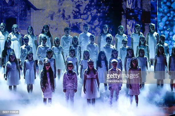 A children's choir performs at the Ein Herz Fuer Kinder Gala 2015 show at Tempelhof Airport on December 5 2015 in Berlin Germany