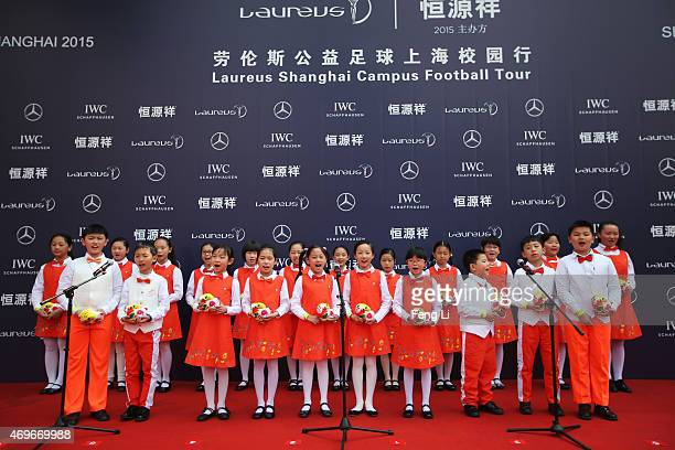 A childrens choir sings during a Laureus Shanghai Football Campus Tour prior to the Laureus World Sports Awards 2015 at Datong Middle School on April...