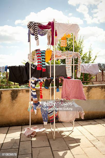 Children's clothes drying on clothes horse