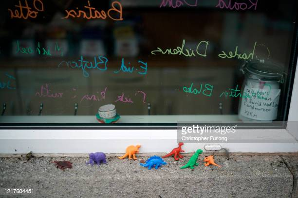 Children's dinosaur figures sit on a window sill at Oldfield Brow Primary School during the coronavirus lockdown on April 08 2020 in Altrincham...