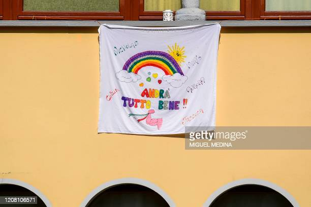 A children's drawing featuring a rainbow and reading Everything will be OK is pictured in the village of Vertova near Bergamo Lombardy on March 24...
