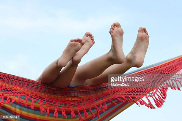 children's feet in hammock - jj girls ストックフォトと画像