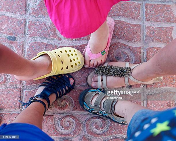 Children's feet with variety of shoes