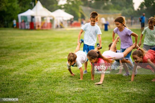 children's game in the park - day stock pictures, royalty-free photos & images