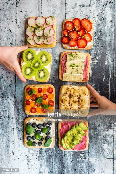 Childrens hands taking garnished sandwiches