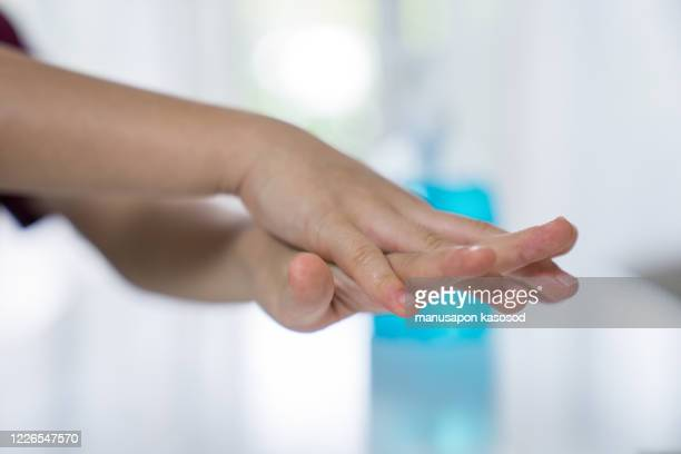 children's hands washed with alcohol gel. - disinfection stock pictures, royalty-free photos & images