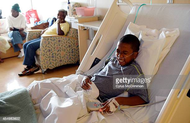 Children's Hospital Colorado is seeing high numbers of respiratory illnesses 9yearold patient Jayden Broadway of Denver winces from his medical...