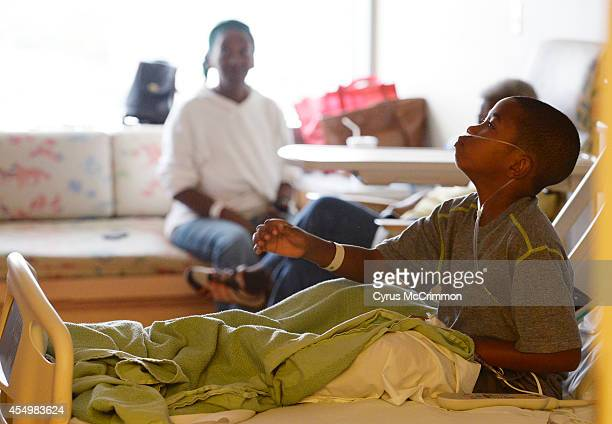 Children's Hospital Colorado is seeing high numbers of respiratory illnesses 9yearold patient Jayden Broadway of Denver sits up in his hospital bed...