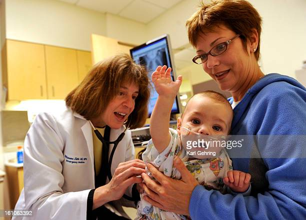 CD16HEALTHINFO Children's Hospital physician Marion Sills left examined Max Kile 6 monthsold in the emergency department of because he had trouble...