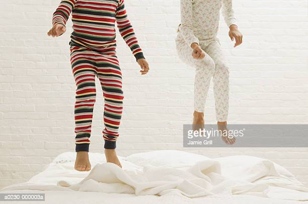 Children's Legs Jumping on Bed
