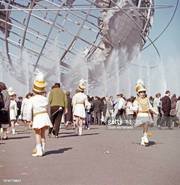 A children's marching band performs in front of the Unisphere in Flushing Meadows Park during the World's Fair in Queens New York New York June 1965