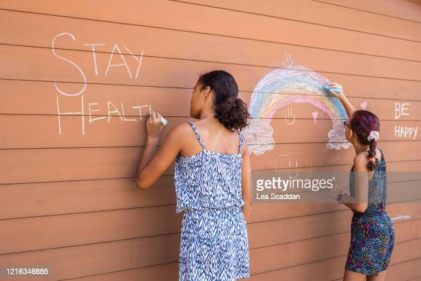 children's messages during covid-19 outbreak - lockdown stock pictures, royalty-free photos & images