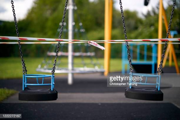 A children's play park is taped off to prevent the equipment being used during the pandemic lockdown on May 01 2020 in Northwich United Kingdom...