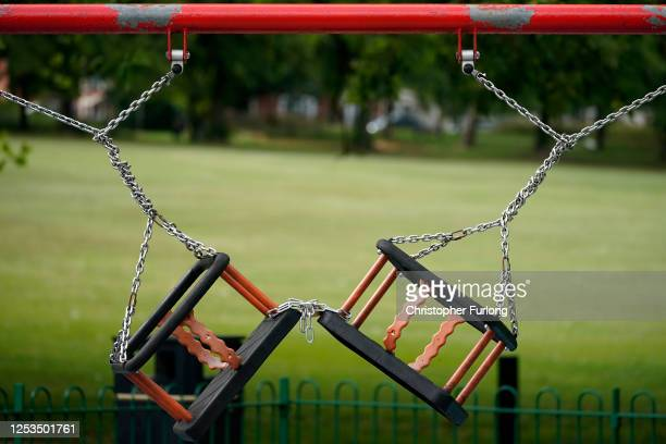 Children's play swings remained locked and chained, due to the pandemic, in Spinney Hill Park before non-essential shops close for the localised...
