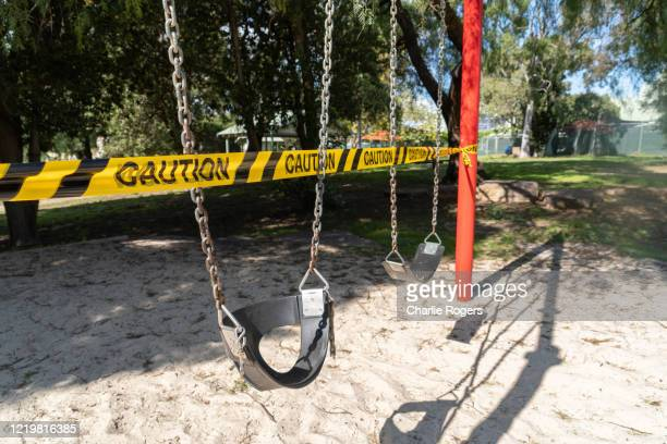children's playground equipment closed because of covid-19 - melbourne australia stock pictures, royalty-free photos & images