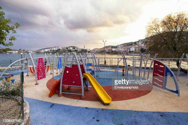 children's playground near the shoreline in datca - emreturanphoto stock pictures, royalty-free photos & images
