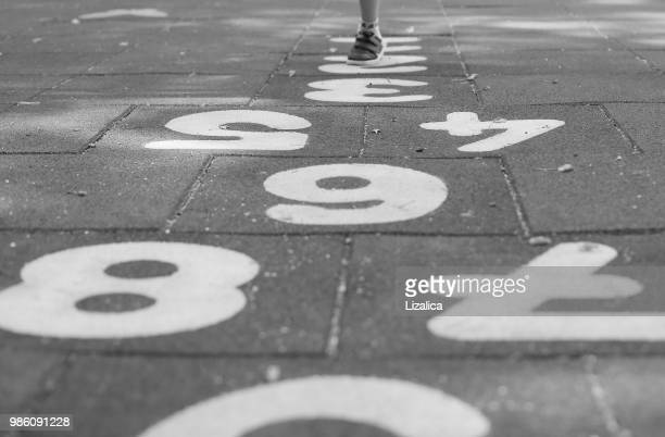 children's playground - hopscotch stock pictures, royalty-free photos & images