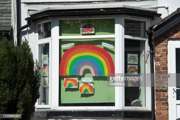Childrens' Rainbows in the window of the Swans Nursery on April 22, 2020 in Manchester, England The British government has extended the lockdown...