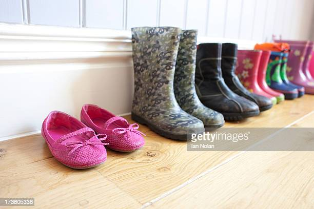 Childrens shoes lined up on floor