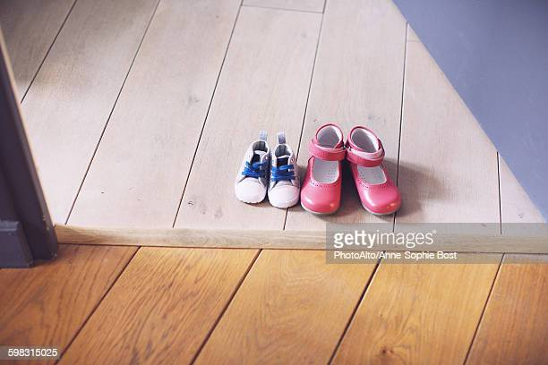 Childrens shoes side by side on floor
