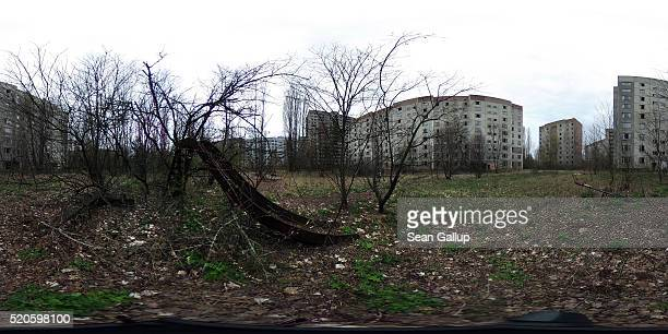 A children's slide stands among former apartment buildings on April 9 2016 in Pripyat Ukraine Pripyat built in the 1970s as a model Soviet city to...