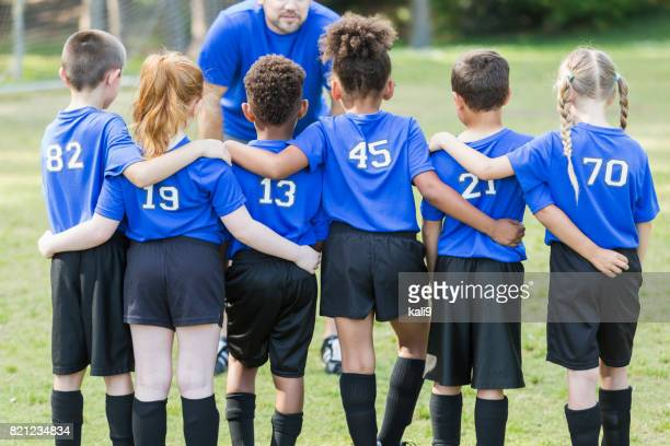 children's soccer team talking with coach - soccer team stock pictures, royalty-free photos & images