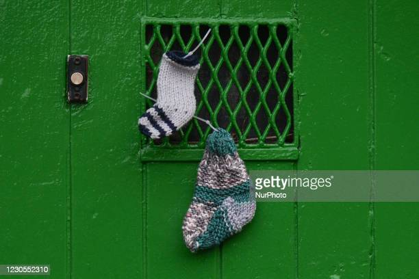 Children's socks left at the front door of the former Magdalene Laundry site on Sean McDermott Street, in Dublin. The Mother and Baby Homes...