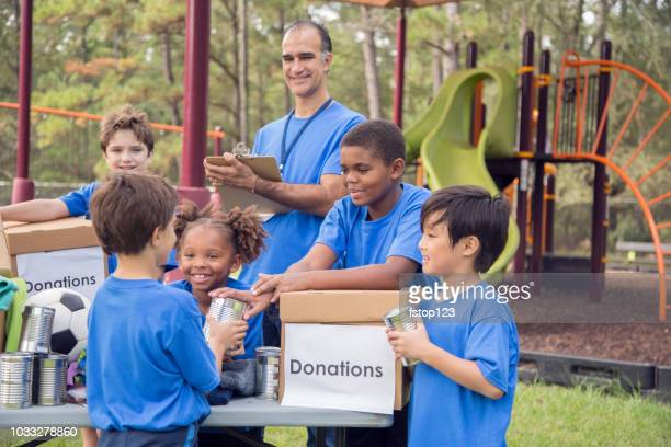 children's sports team charity drive for donations, local disaster relief. - emergency management stock pictures, royalty-free photos & images