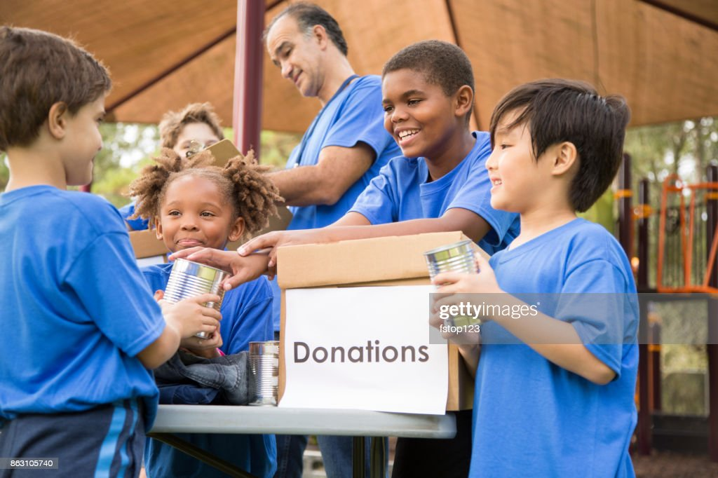 Children's sports team charity drive for donations, local disaster relief. : Stock Photo