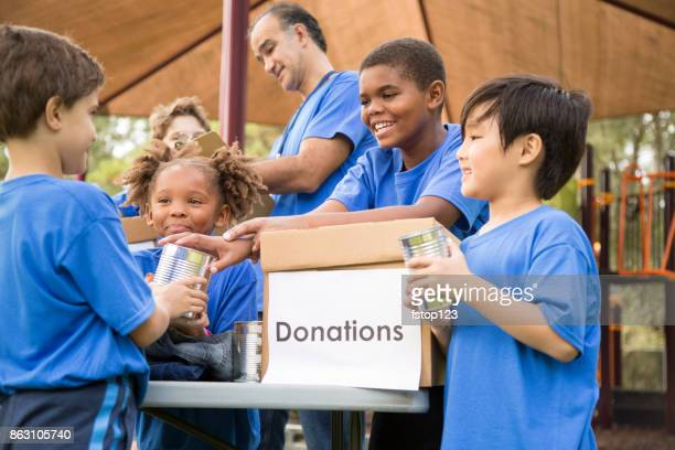 children's sports team charity drive for donations, local disaster relief. - charity benefit stock pictures, royalty-free photos & images